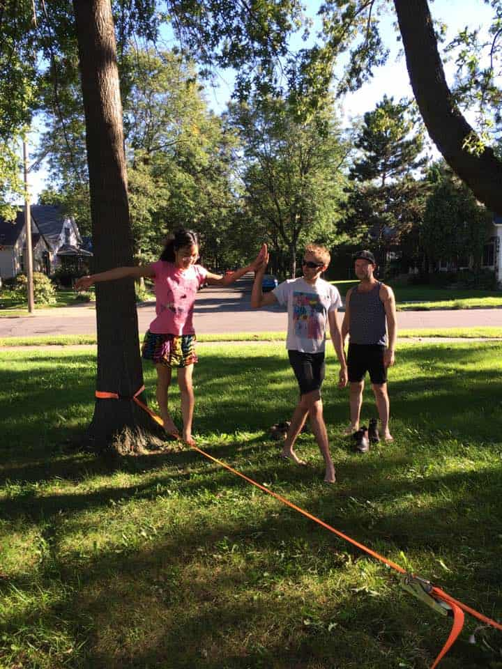 Our friends' kid learning how to slack line outside with us.
