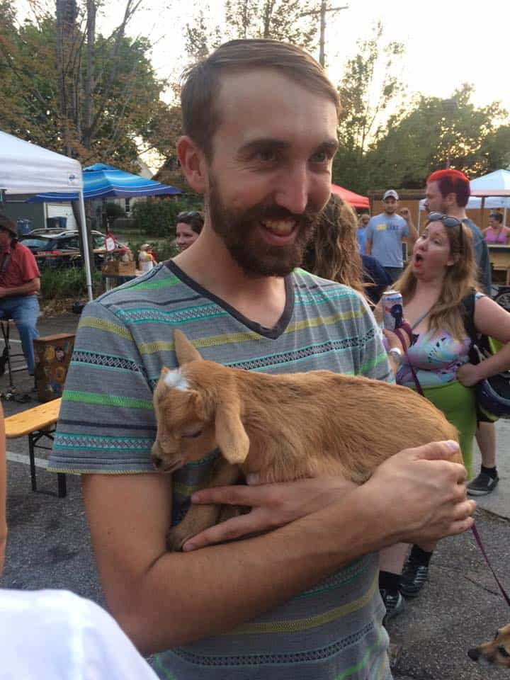 Seth holding a baby goat.