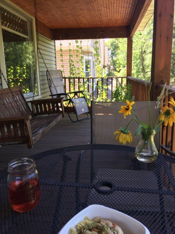 Our front porch, where we like to have dinner in the summer.